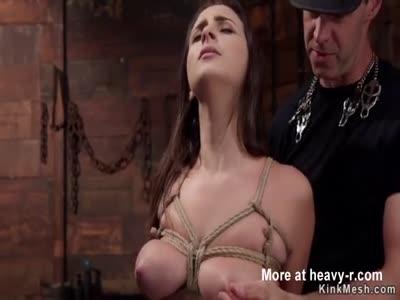 Busty slave rides big cock masked master