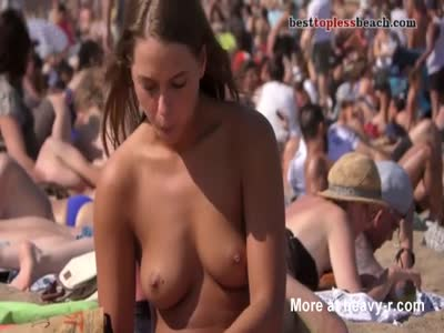 Wonderful brunette girl Topless on the Beach