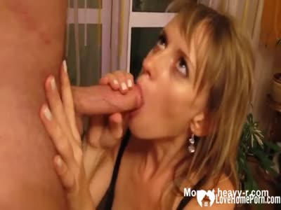 Pretty MILF sucking and eating cum