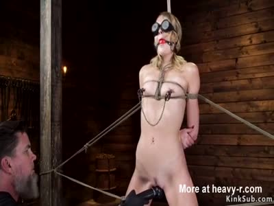 Gagged blonde fucked in suspension