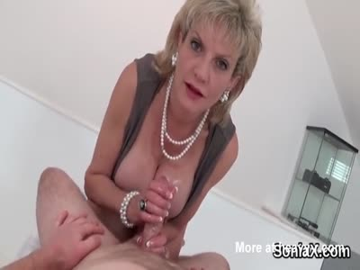 Busty Mature Oiled Handjob