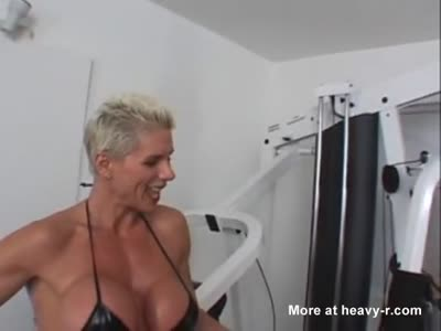 Muscular girl fucks submissive chick with strapon