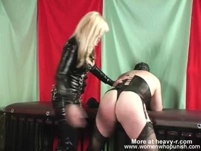 Spanking Crossdressing Guy