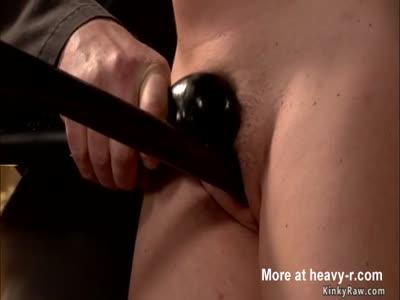 Busty redhead rides Sybian in bondage
